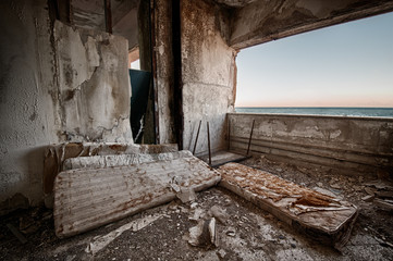 The interior of a building in ruins on the coast of Sicily.