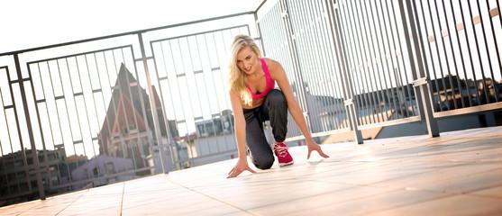 Blond athlete preparing to run