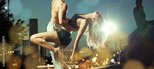 Leinwandbild Motiv Strong guy holding his alluring girlfriend