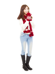happy young beautiful woman in winter clothes and thinking