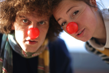 Close up portrait of two curious clowns