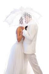 Bride and groom with a umbrella