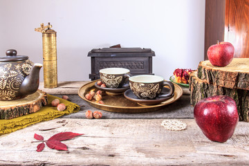 cups of tea on old wooden table