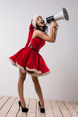 Christmas woman shouting with a megaphone