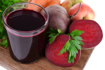 Glass of fresh beet juice and vegetables