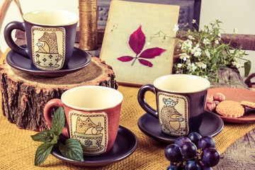 three empty cups for tea on retro wooden table