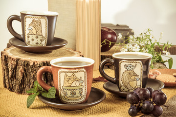 three retro empty cups for tea on retro wooden table