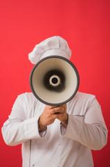 Portrait of caucasian man with chef uniform holding megaphone