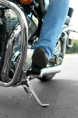 Bikers boot on open road, close-up