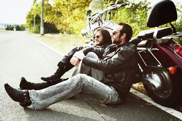 Biker men sitting near bike and relaxing