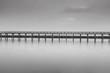 Calm scene in black and white of wooden bridge