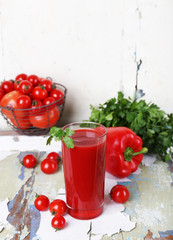 Glass of tomato juice and fresh vegetables