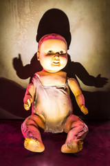 Scary creepy doll sitting