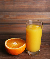 Glass of orange juice and fresh orange