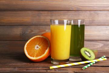 Orange and kiwi juice and fresh fruits