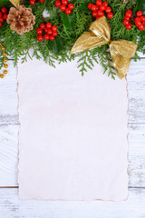 Christmas decoration with paper shit on wooden background