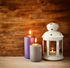 Vintage Lantern with burning Candle on wooden table