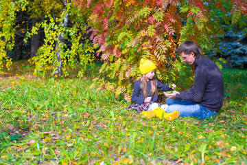 Father with cute daughter in autumn park outdoors