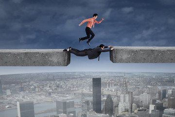 Businessman runs above his partner