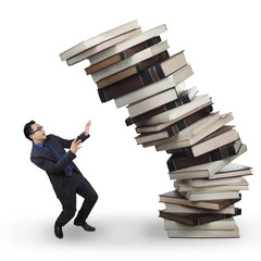 Businessman with falling books