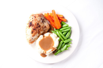 roasted chicken breast with mashed potatoes, gravy and fresh veg