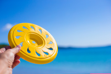 Close up frisbee background a tropical beach and sea