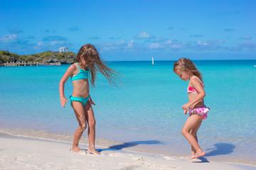 Little girls enjoy their summer vacation on the beach