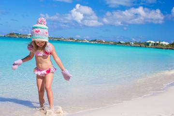 Little cute adorable girl on tropical beach