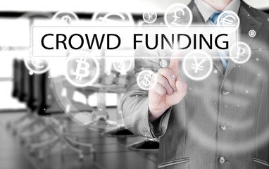 Businessman pushes virtual crowd funding button