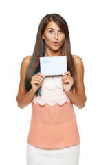 Surprised woman showing blank envelope