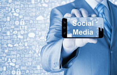 business man hand holding smartphone with Socail Media