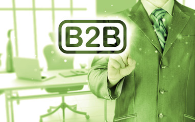 businessman pointing to word B2B, business-to-busines