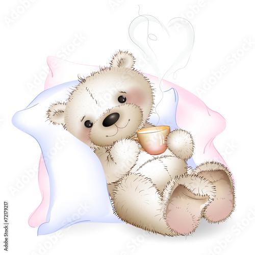 obraz PCV Miś leżąc w łóżku na poduszkach