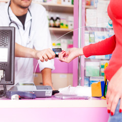 Customer paying with credit card at doctor