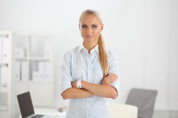 Attractive businesswoman with her arms crossed  standing in