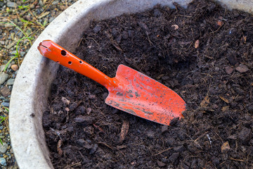 garden trowel and soil in tray