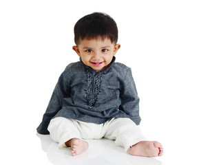 Cute asian baby sitting on the floor