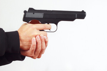 Hands with army handgun on a white background