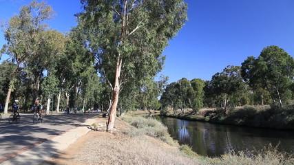 the bicycle road along the river yarkon .tel aviv. israel