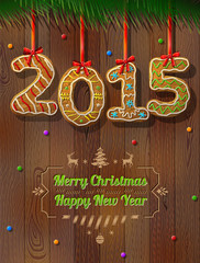 New Year 2015 in shape of gingerbread against wood background
