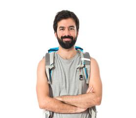 Backpacker with his arms crossed over white background