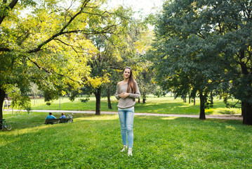 Young woman portrait outdoors in a park.