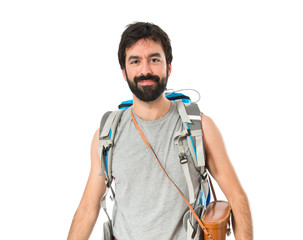 Young backpacker over white background