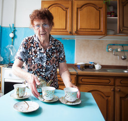 Elderly woman on the kitchen