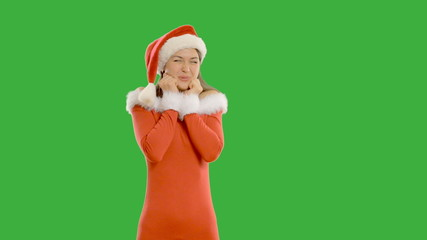 Young charming girl shows copy space in santa claus hat