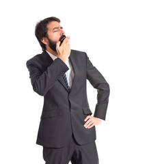 Businessman yawning over isolated white background