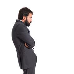 Sad businessman over isolated white background
