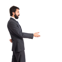 Businessman making a deal over isolated white background