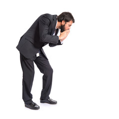 Businessman shouting down over isolated white background