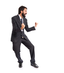 Lucky businessman over isolated white background